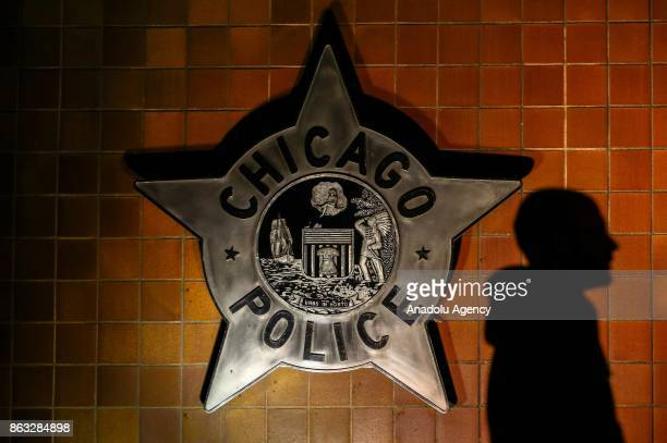 People gather in front of the Chicago Police Department where they stage a demonstration following the shooting of Laquan McDonald shot and killed by...