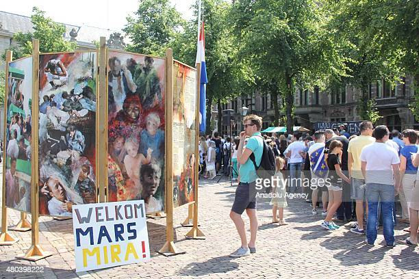 People gather in front of the Dutch Parliament in the Hague to commemorate the victims of Srebrenica massacre at the 20th anniversary of it on July...