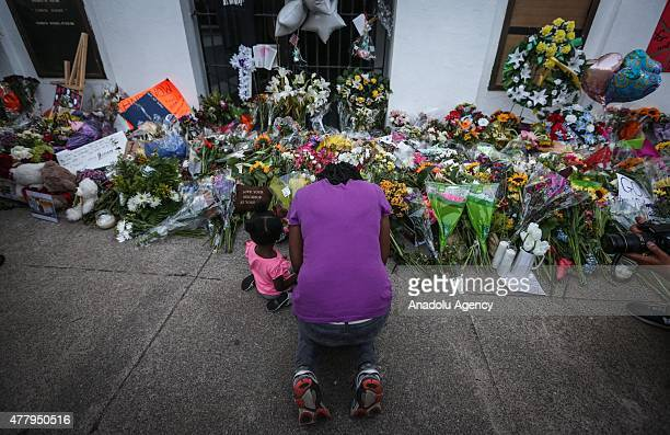People gather in front of the Emanuel AME Church to pay respect to the nine shooting victims on June 20 in Charleston, South Carolina, USA.