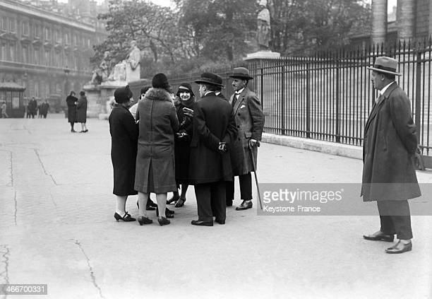 People gather in front of the Palais Bourbon in October 1929 in Paris France