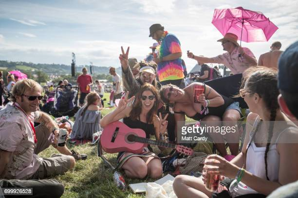 People gather in front of the Pyramid Stage at the Glastonbury Festival site at Worthy Farm in Pilton on June 22 2017 near Glastonbury England The...