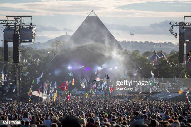 People gather in front of the Pyramid Stage at Worthy Farm in Pilton on June 25 2017 near Glastonbury England Glastonbury Festival of Contemporary...