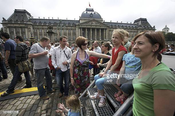 People gather in front of the Royal Palace in Brussels on June 6 2010 for an outdoor concert aimed at reinforcing solidarity dialog respect community...
