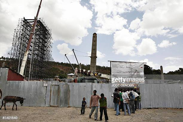 People gather in front of the site where the 1700yearold Axum obelisk is being restored on 04 June 2008 in Ethiopia Italian soldiers carted away the...