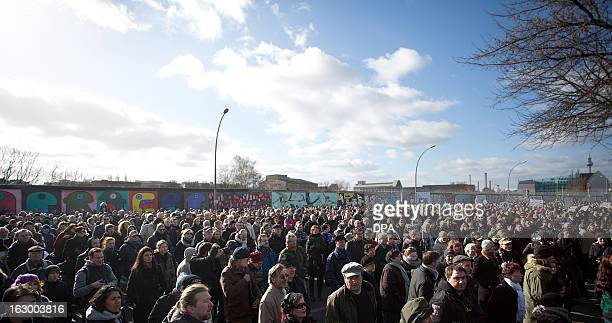 People gather in front of the socalled East Side Gallery the Berlin Wall's longest remaining to demonstrate against the dismantling of a segment of...