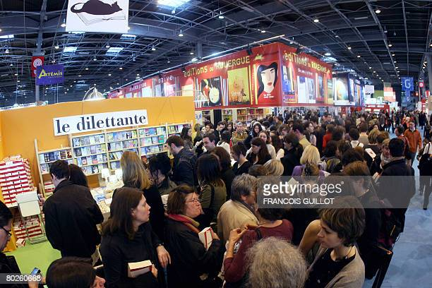 People gather in front of the stand of French publisher La Dilettante where French writer Anna Gavalda signs her book 'La consolante' during the 28th...