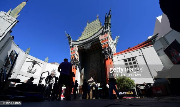 People gather in front of the TCL Chinese Theater in Hollywood, California on March 29, 2021 where four directors of current and previous Godzilla...