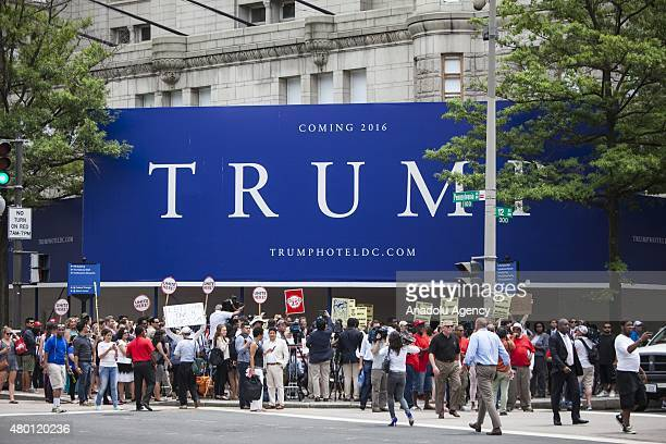 People gather in front of the under construction Trump Hotel to protest Donald Trump candidate for the Republican Presidential ticket after he made...