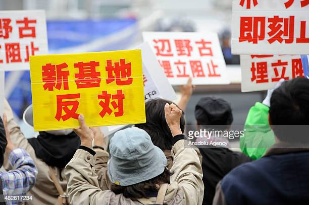 People gather in front of the US Marines Camp Schwab in Okinawa Japan to protest against the construction of the new US base at Henoko in Okinawa...