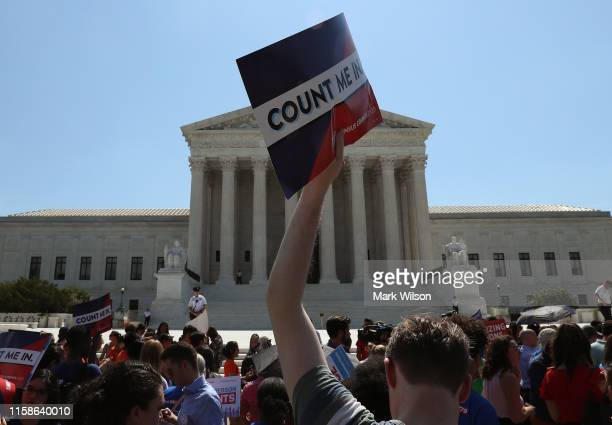 People gather in front of the US Supreme Court after several decisions were handed down on June 27 2019 in Washington DC The high court blocked a...
