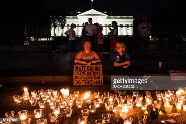 TOPSHOT People gather in front of the White House on August 13 2017 in Washington DC for a vigil in response to the death of a counterprotestor in...