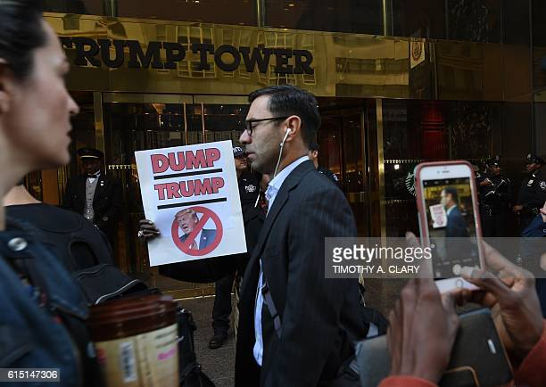 People gather in front of Trump Tower October 17 2016 in New York to protest against Donald Trump's 'treatment of women' during a rally against the...