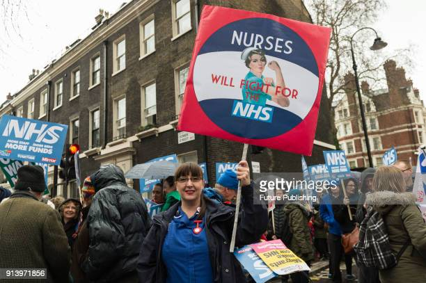People gather in Gower Street ahead of a march through central London towards Downing Street to protest against underfunding and privatisation of the...