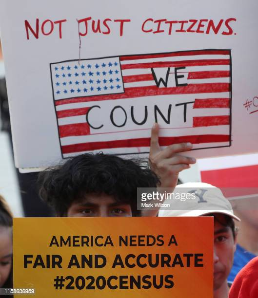 People gather in in front of theUS Supreme Court as decisions are handed down on June 27 2019 in Washington DC The high court blocked a citizenship...