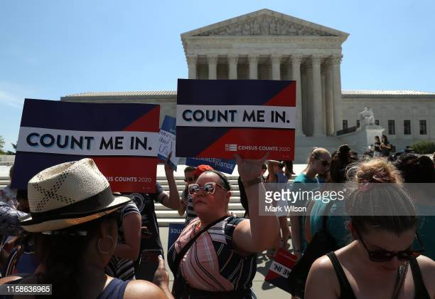 People gather in in front of the U.S. Supreme Court as decisions are handed down on June 27, 2019 in Washington, DC. The high court blocked a...