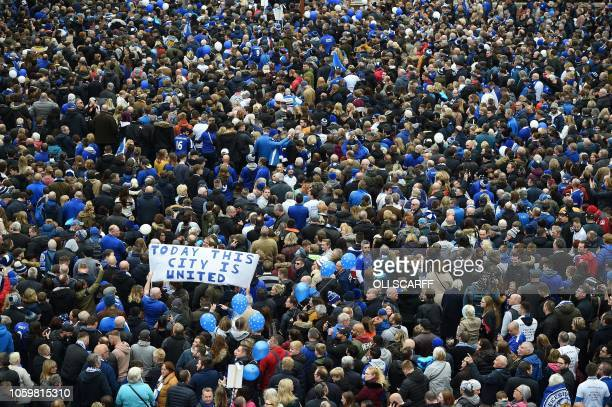 TOPSHOT People gather in Jubilee Square to take part in the Vichai March or the 50001 march towards the King Power Stadium in honour of Leicester...