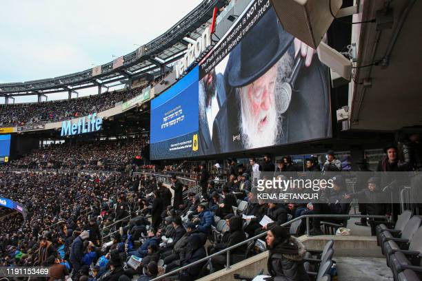 People gather in MetLife Stadium on January 1 in East Rutherford New Jersey to mark the Siyum HaShas an event that celebrates the completion of the...