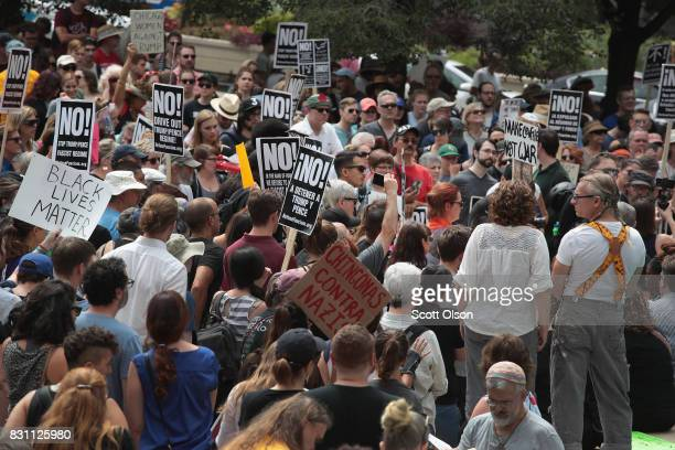 People gather in Millennium Park to protest the altright movement and to mourn the victims of yesterdays rally in Charlottesville Virginia on August...
