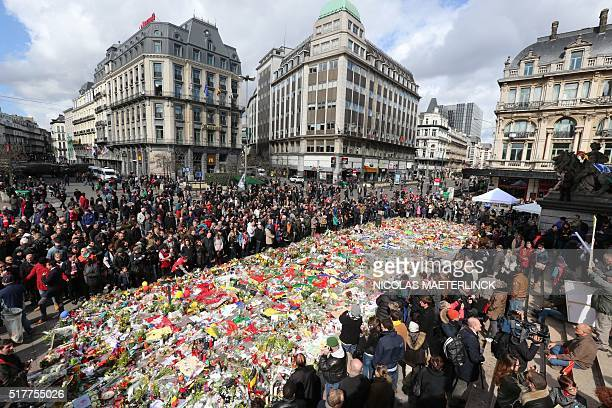 People gather in Place de la Bourse square at a makeshift memorial to pay tribute to the victims of Brussels terror attacks, in Brussels, on March...