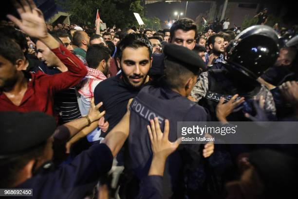 People gather in protest outside the Prime Minister's office on Wednesday June 6 in Amman Jordan Angry protesters refused and forced the professional...