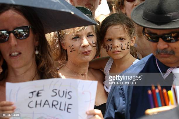 People gather in SaintDenisdelaReunion on the French overseas island of La Reunion on January 11 2015 following three days of terror and twin siege...