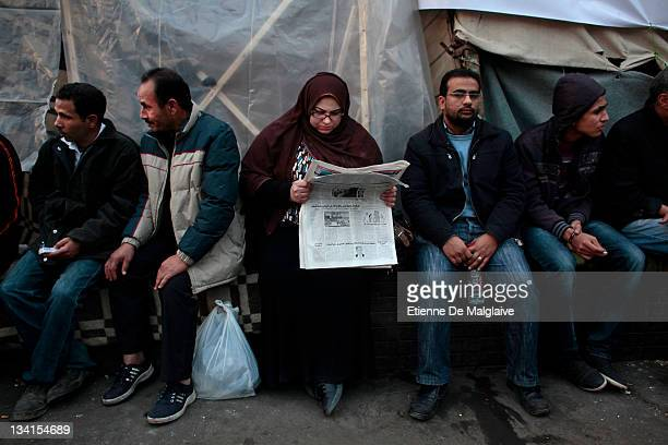People gather in Tahrir Square on November 27 2011 in Cairo Egypt Thousands of Egyptians are continuing to occupy Tahrir Square ahead of...