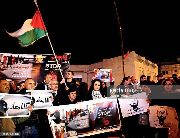People gather in the city square of the West Bank town of Beit Sahur to commemorate the victims of the latest ISIS terror killings Following another...