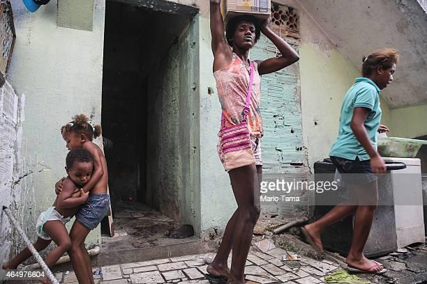 People gather in the Complexo da Mare 'favela' complex one of the largest 'favela' complexes in Rio on March 2 2015 in Rio de Janeiro Brazil The...
