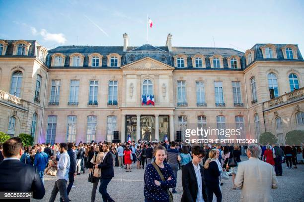 People gather in the courtyard of the Elysee Palace in Paris on June 21 during the annual 'Fete de la Musique'