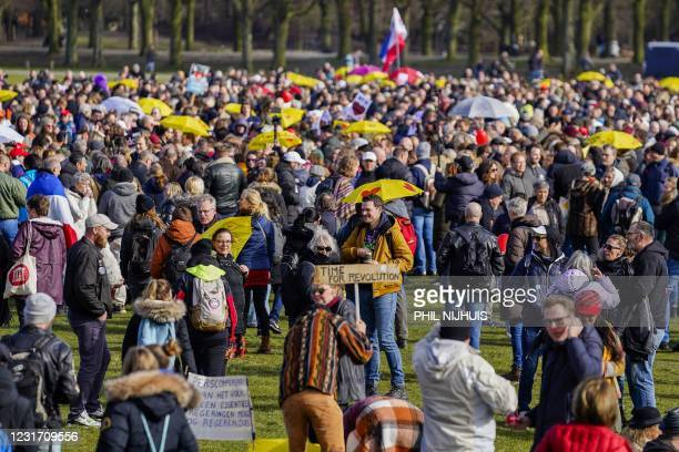 People gather in the Hague, on March 14 during a rally to protest government restrictions aimed at stopping the spread of the coronavirus. -...
