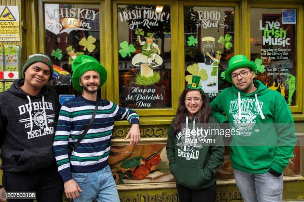 People gather in the popular Temple bar area of Dublin on March 17 as St Patrick's Day festivities are cancelled and pubs shut in reaction to the...