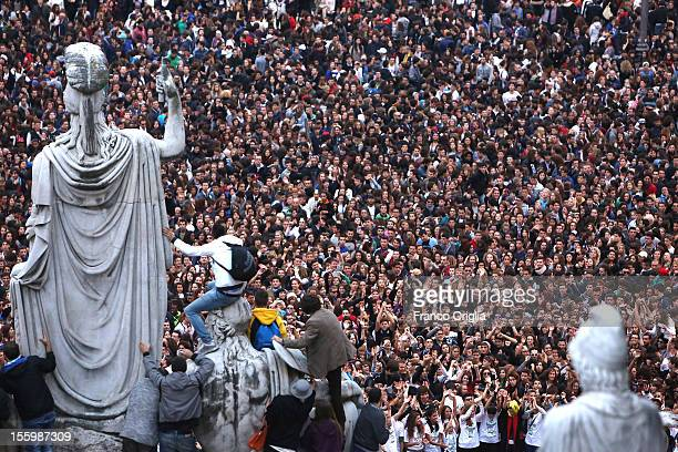 People gather in the Roman central Square of Piazza del Popolo for a Gangnam Style Flashmob on November 10 2012 in Rome Italy
