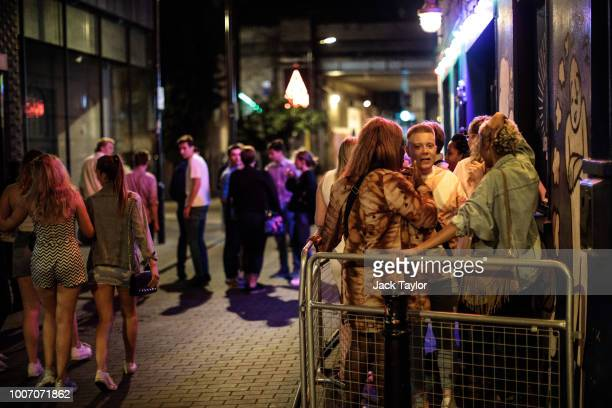 People gather in the smoking area outside a bar Shoreditch the weekend before new licensing rules come in to effect across Hackney on July 28 2018 in...