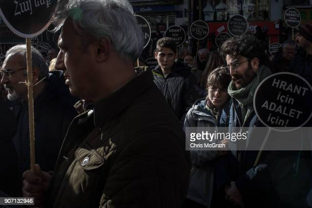 People gather in the street and chant slogans during the 11th anniversary of the assassination of journalist Hrant Dink outside the Agos Newspaper...
