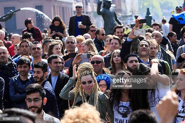 People gather in the street at th annual Myfest in District Kreuzberg afternoon before several demonstrations on May 2016 in Berlin Germany Tens of...