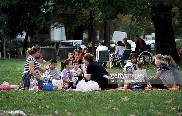 People gather in the streets and parks near Skpoje, on September 11 after a moderate 5.3-magnitude earthquake, preceded by two tremors, struck the...
