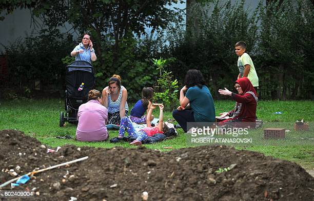 People gather in the streets and parks near Skpoje on September 11 after a moderate 53magnitude earthquake preceded by two tremors struck the...