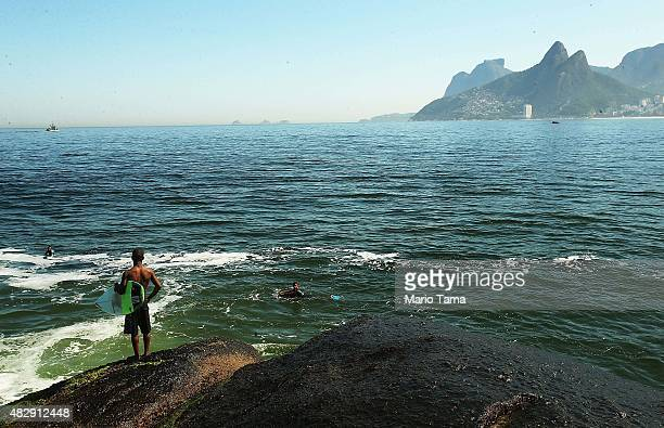 People gather in the water off Arpoador outside Guanabara Bay on August 3 2015 in Rio de Janeiro Brazil The Rio government promised to clean 80...