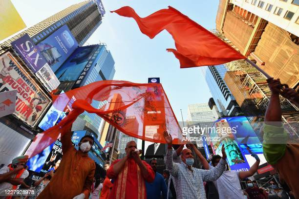 People gather in Times Square to celebrate the building of a temple on disputed grounds in northern India on August 5, 2020 in New York City. - A...