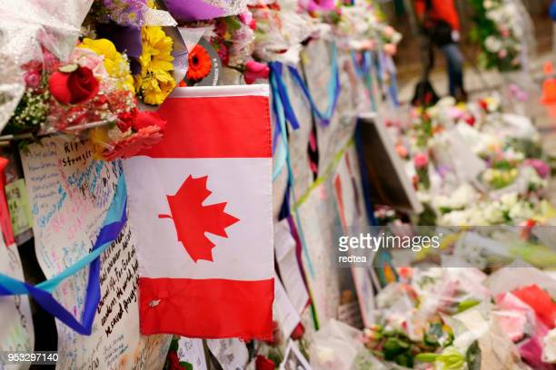 people gather in toronto's olive square on sunday to honour the victims killed in a deadly van attack . - national holiday stock pictures, royalty-free photos & images