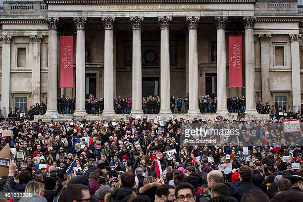 People gather in Trafalgar Square to show their respect to victims of the terrorist attacks in Paris on January 11 2015 in London England London...