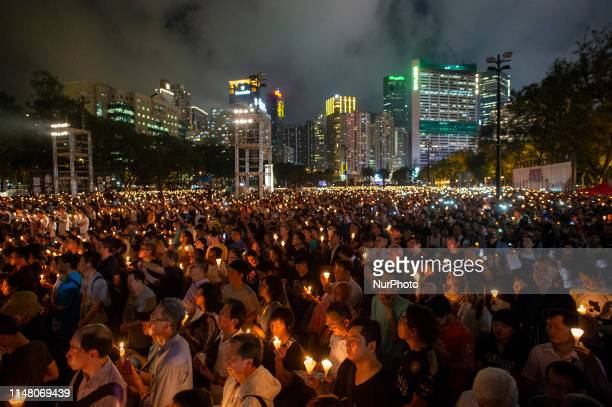 People Gather in Victoria Park to attend a vigil in Hong Kong, China. 4 June 2019. Thousands of People Participated in an annual Candlelight vigil in...