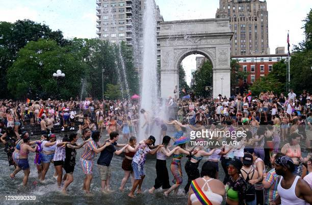 People gather in Washington Square Park for the 3rd annual Queer Liberation March in New York on June 27, 2021. - This weekend's Pride marches in...