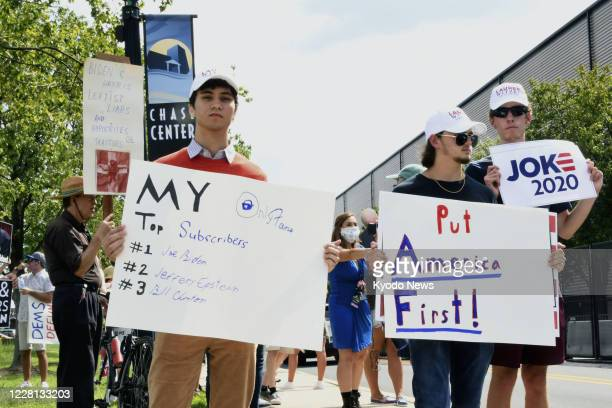 People gather in Wilmington, Delaware, on Aug. 20 to express their disapproval of Democratic presidential nominee Joe Biden near the venue where the...