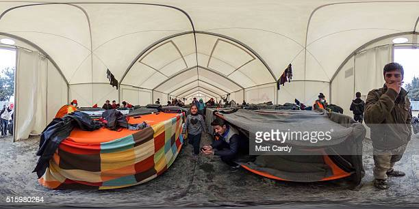 People gather inside a accommodation tent at the Idomeni refugee camp on the Greek Macedonia border on March 16 2016 in Idomeni Greece The decision...
