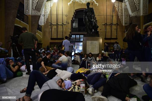 People gather inside a wouldbe polling station in Barcelona on October 1 to prevent the police to seal it off in a referendum on independence for...