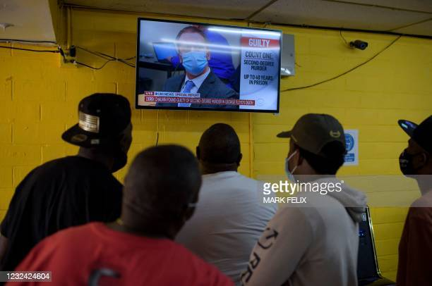 People gather inside the Twees Foods Store in the Third Ward where George Floyd grew up in Houston, Texas, to watch the the verdict in Derek...
