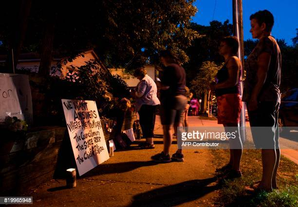 People gather near a memorial for Justine Damond on July 20 2017 in Minneapolis Minnesota Several days of demonstrations have occurred after the...
