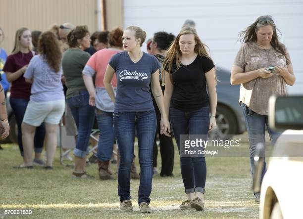People gather near First Baptist Church following a shooting on November 5 2017 in Sutherland Springs Texas At least 26 people were reportedly killed...