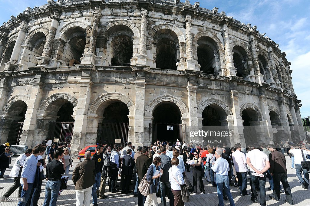 People gather near the arena in Nimes, southern France, on May 20, 2010 during the Nimes Feria Bullfighting Festival (Feria de la Pentecote).